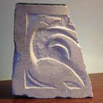 Laura Travis, Swan, Limestone relief carving.
